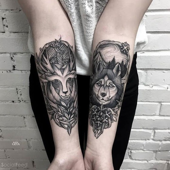 Engraving style black ink forearm tattoo of deer with wolf and flowers