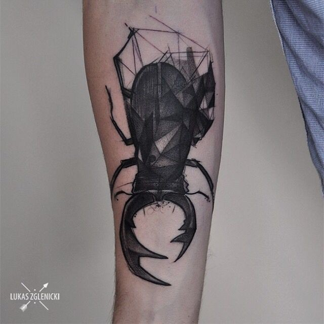 Engraving style black ink forearm tattoo of big bug with horns