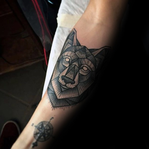 Engraving style black ink forearm tattoo of wolf head
