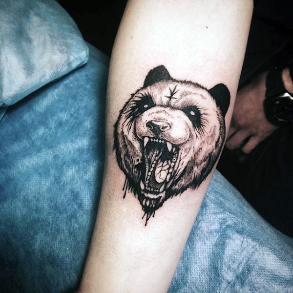 Engraving style black ink forearm tattoo of mystical bear with symbol