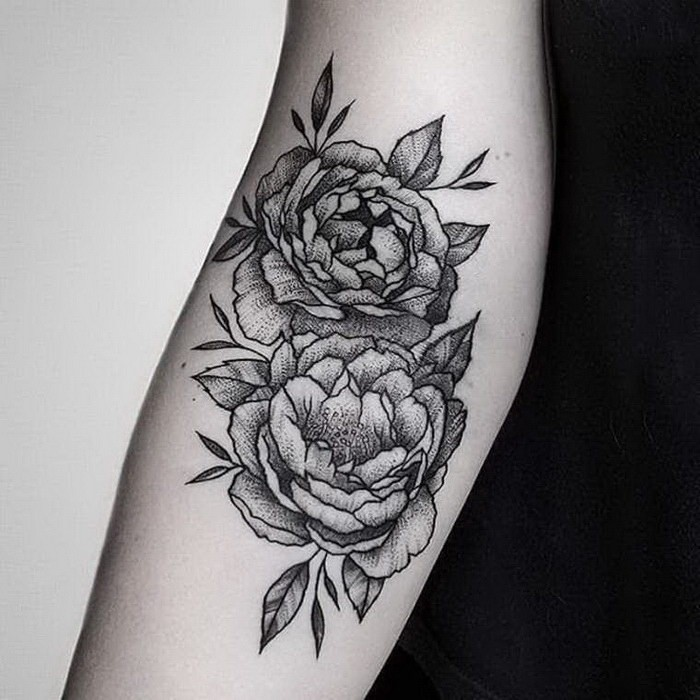 Engraving style black ink forearm tattoo of rose flowers