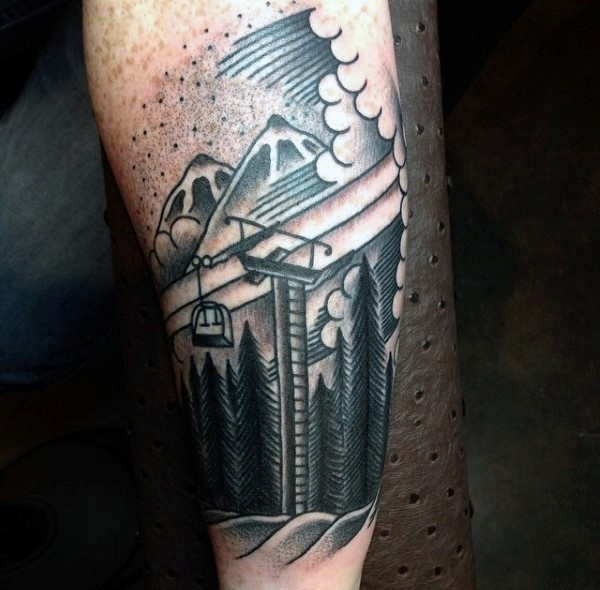 Engraving style black ink forest with mountains tattoo on arm