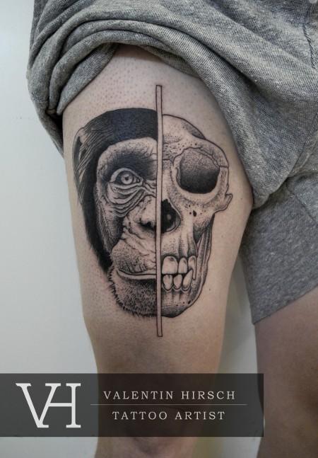 Engraving style black ink half skull half real monkey head tattoo on thigh