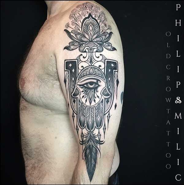 Engraving style black ink half sleeve tattoo of Hamsa with ornaments