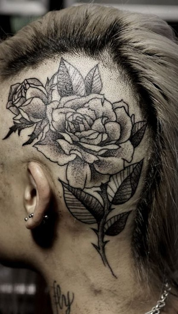 Engraving style black ink head tattoo of nice roses