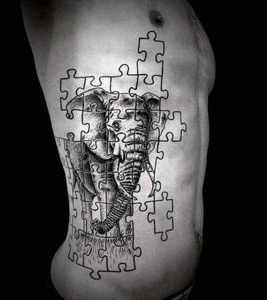 Engraving style black ink large side tattoo of puzzle picture stylized with elephant