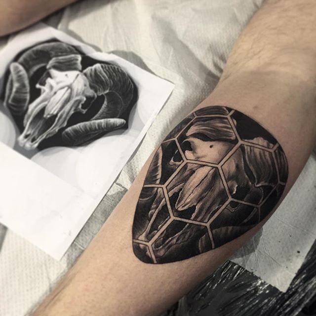 Engraving style black ink leg tattoo of goat skull
