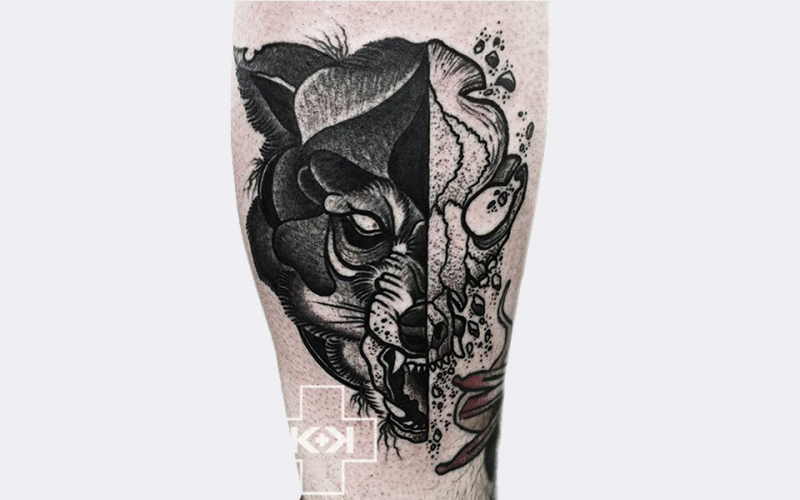 Engraving style black ink leg tattoo of bear head with skull