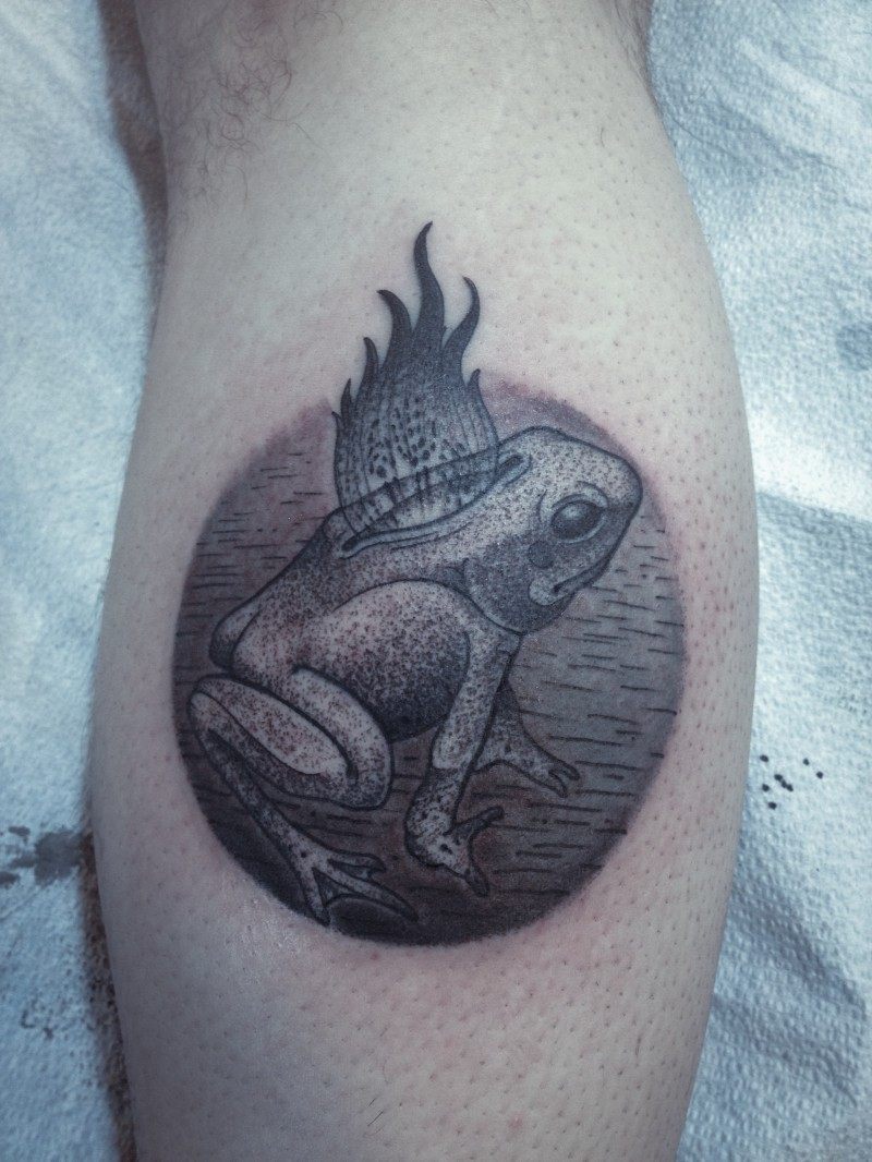 Engraving style black ink leg tattoo of frog with flames