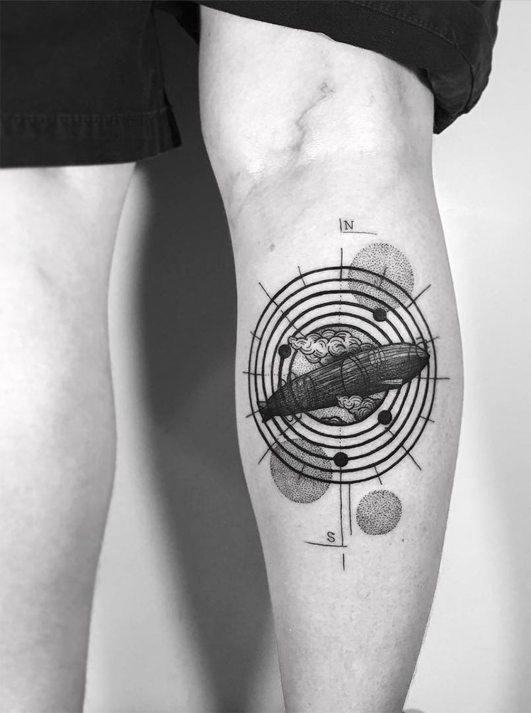 Engraving style black ink leg tattoo of big zeppelin with circles