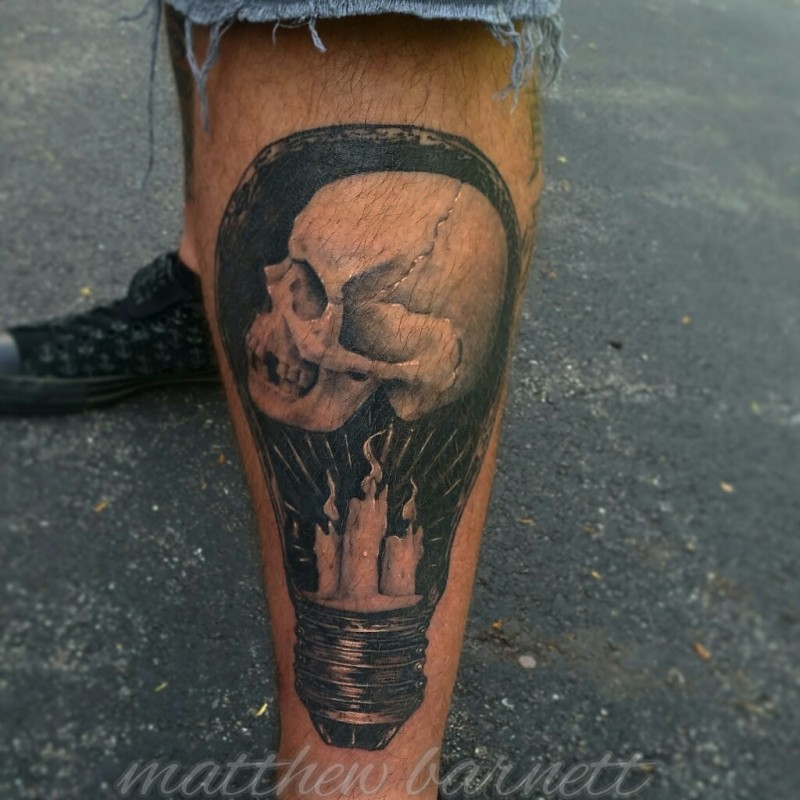 Engraving style black ink leg tattoo of bulb stylized with candles and skulls