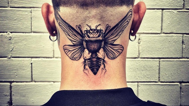 Engraving style black ink neck tattoo of big insect