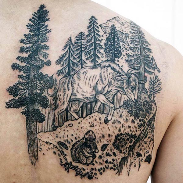 Engraving style black ink scapular tattoo of bull in forest
