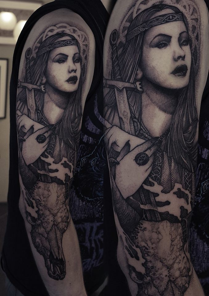 Engraving style black ink shoulder tattoo of beautiful woman with sword
