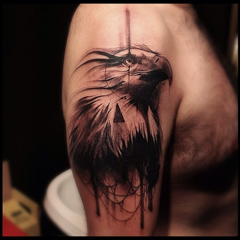Engraving style black ink shoulder tattoo of eagle head with black triangle
