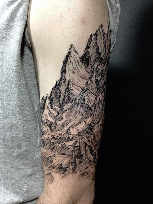 Engraving style black ink shoulder tattoo of big mountains
