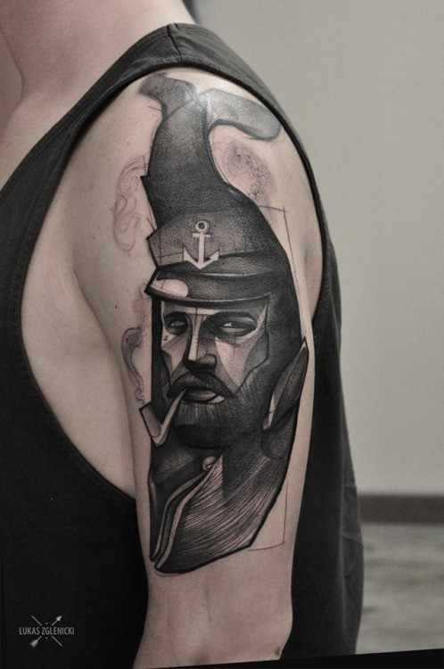 Engraving style black ink shoulder tattoo of smoking sailor face