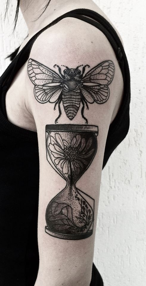 Engraving style black ink shoulder tattoo of bee with sand clock stylized with flowers