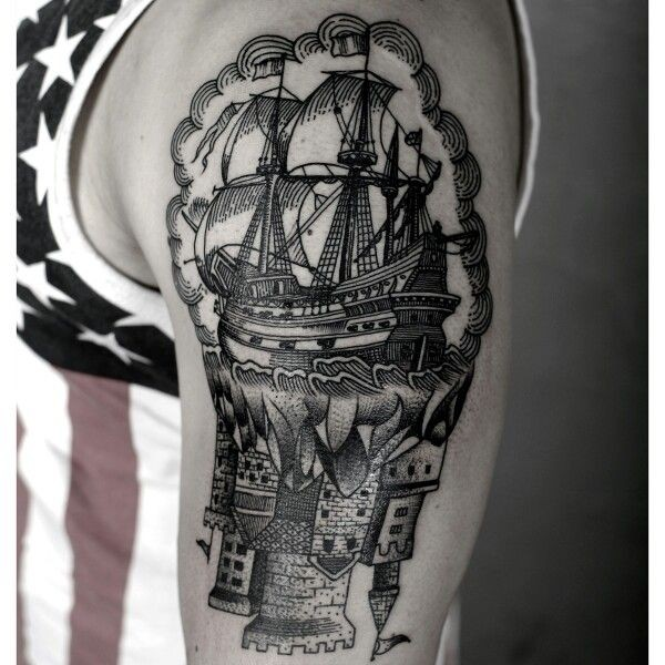 Engraving style black ink shoulder tattoo of old sailing ship with castle