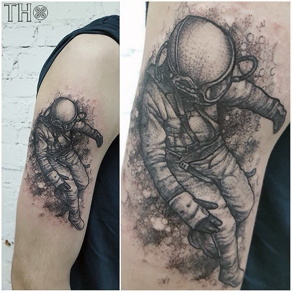 Engraving style black ink shoulder tattoo of vintage space man