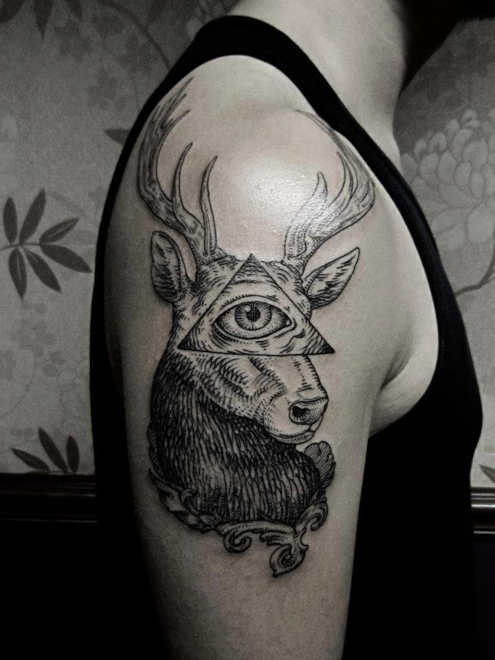 Engraving style black ink shoulder tattoo of deer with human eye and triangle