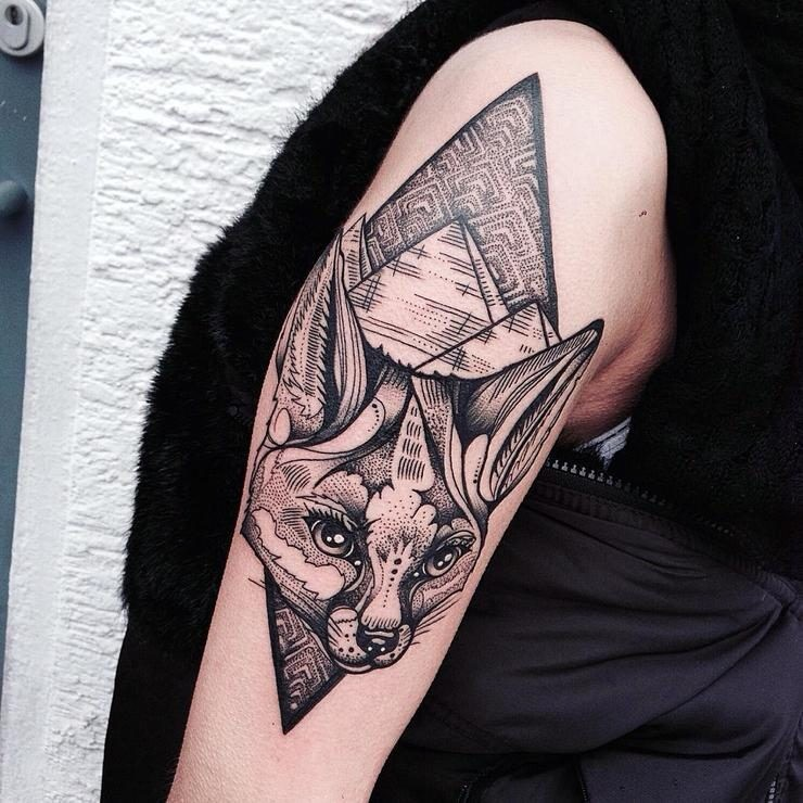 Engraving style black ink shoulder tattoo of fox head with pyramids