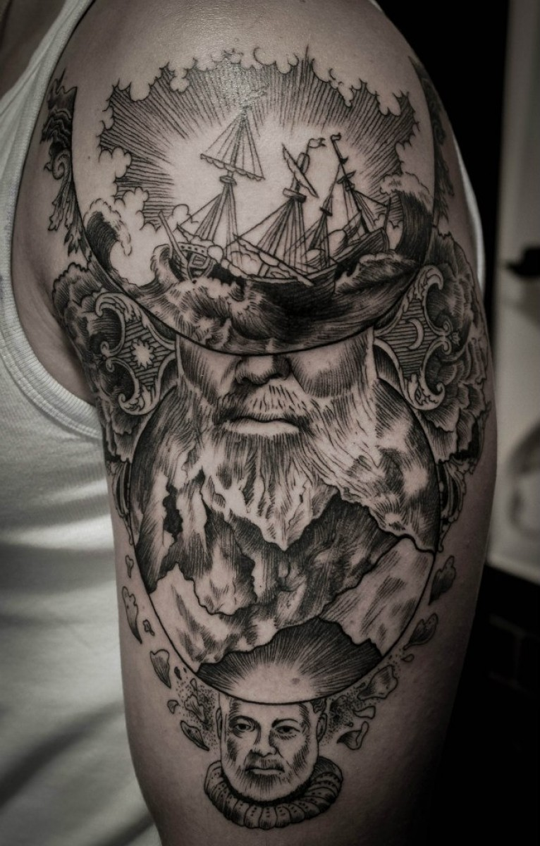 Engraving style black ink shoulder tattoo of man with beard with sailing ship