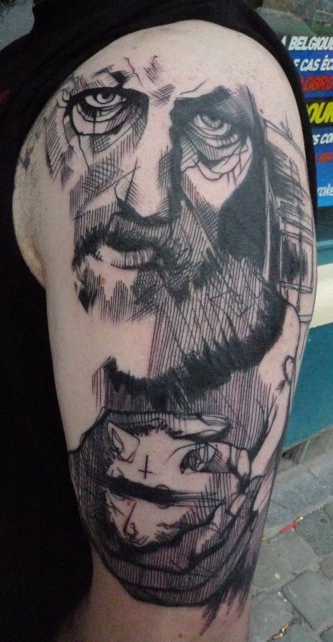 Engraving style black ink shoulder tattoo of old man face with rat
