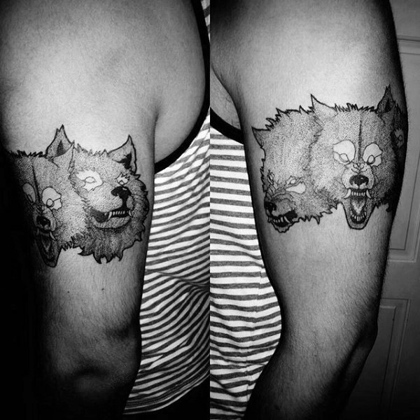 Engraving style black ink shoulder tattoo of creepy dogs