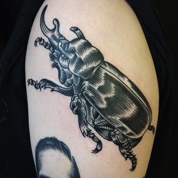 Engraving style black ink tattoo of cool bug