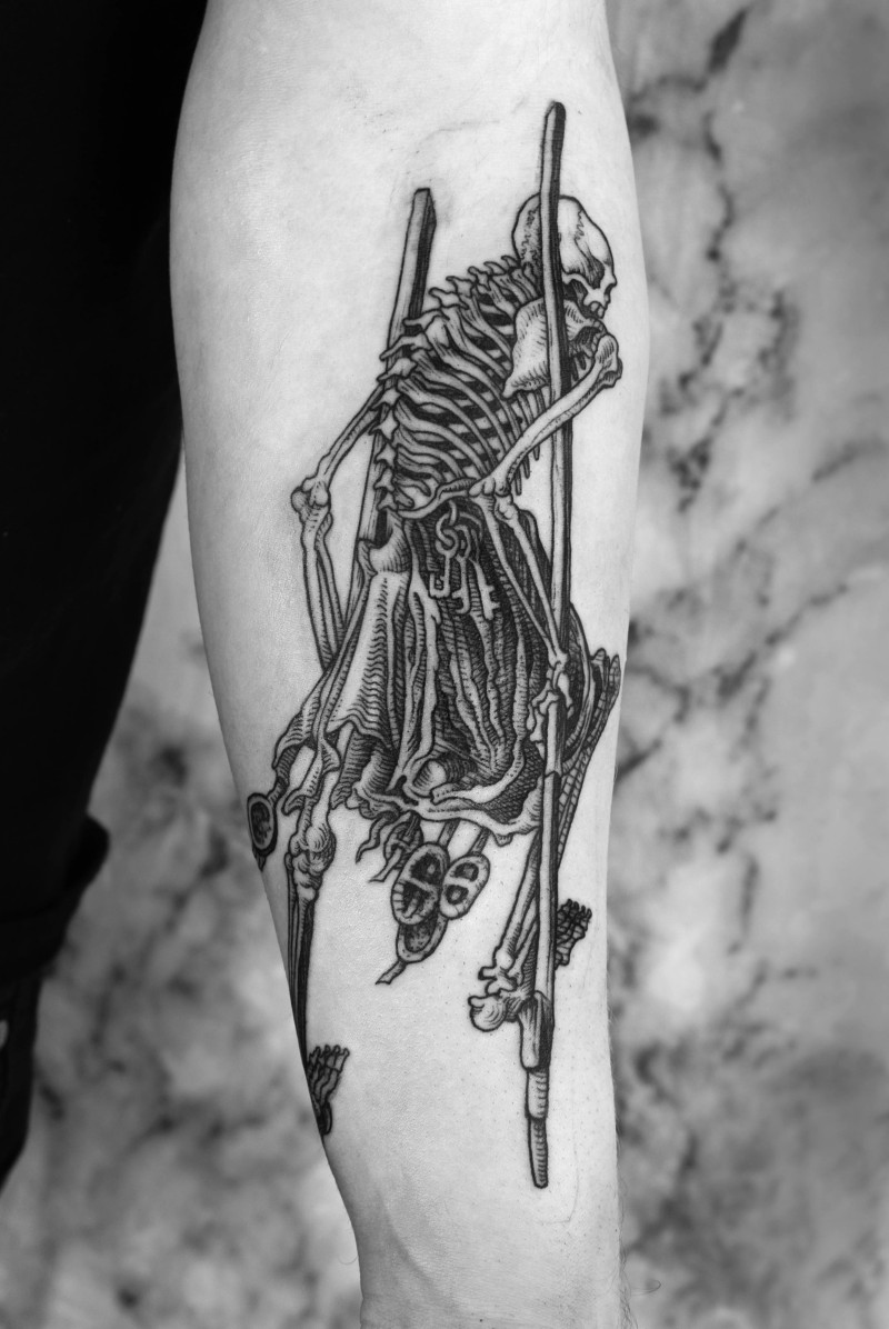 Engraving style black ink tattoo of human skeleton with spike