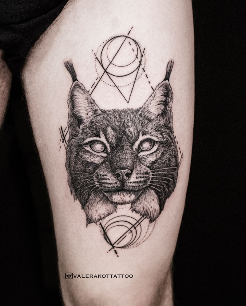 Engraving style black ink thigh tattoo fo wild cat and geometrical figure