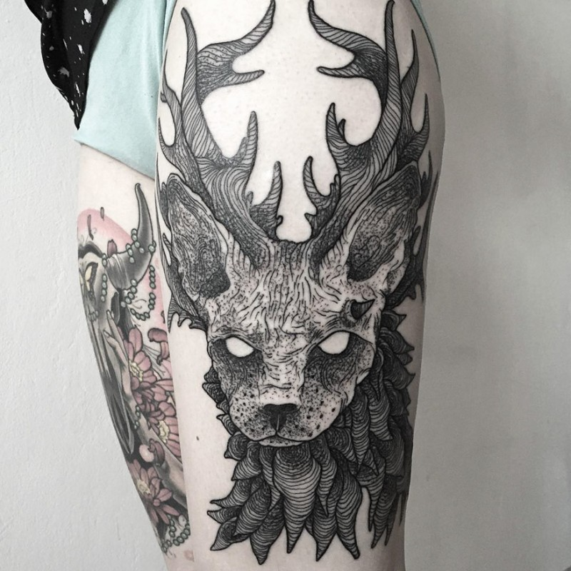 Engraving style black ink thigh tattoo of mystical deer