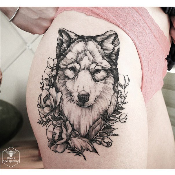 Engraving style black ink thigh tattoo of wolf with flowers