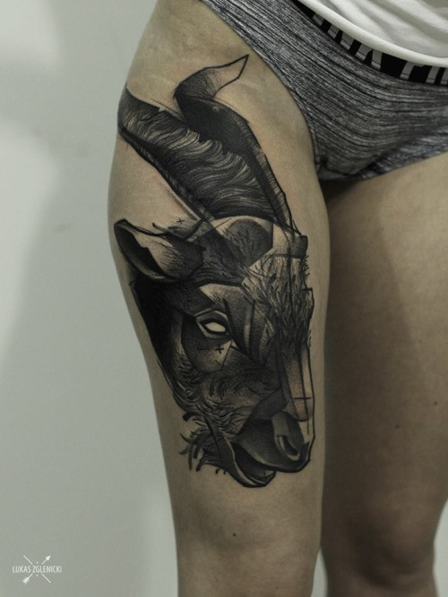Engraving style black ink thigh tattoo of goat head