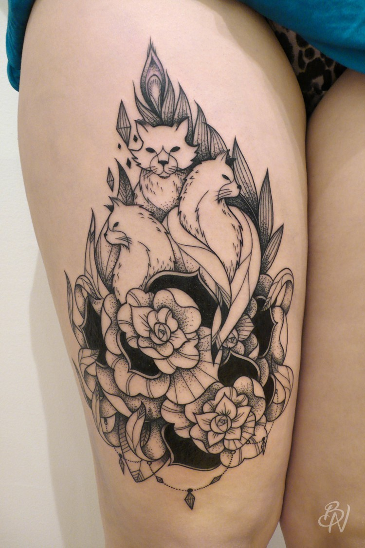 Engraving style black ink thigh tattoo of foxes with flowers