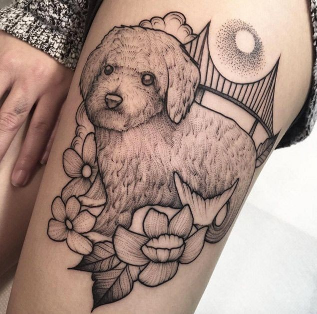 Engraving style black ink thigh tattoo of beautiful dog with flowers and bridge