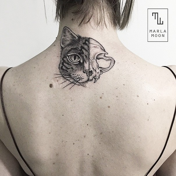 Engraving style black ink upper back tattoo of half cat head split with cat skull