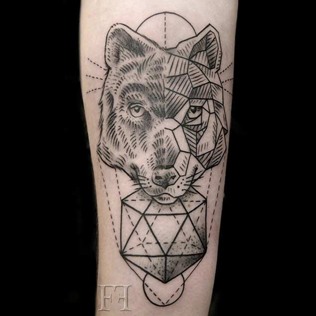 Engraving style black ink wolf head tattoo combined with geometrical ornaments