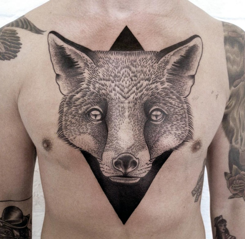 Engraving style chest tattoo of fox head with black rhombus
