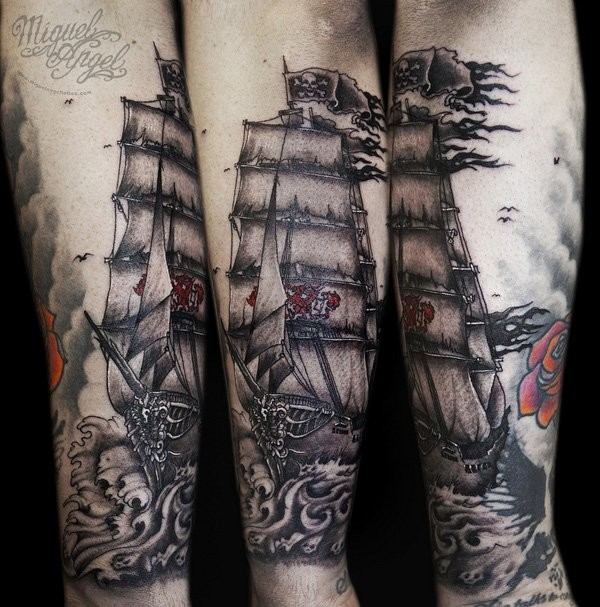 Engraving style colored arm tattoo of pirate sailing ship with flowers