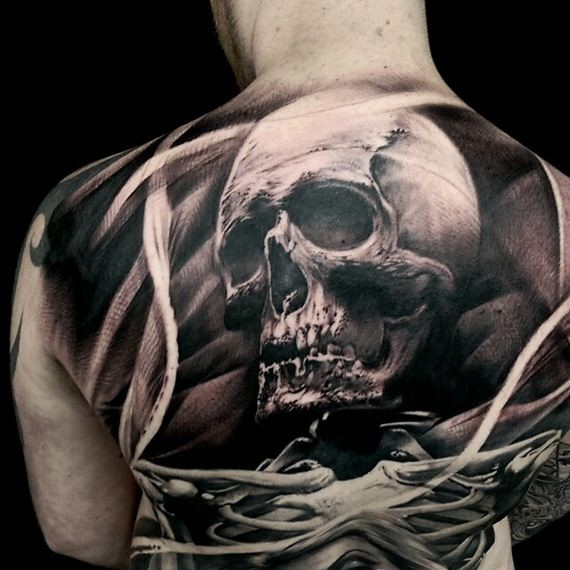 Engraving style colored back tattoo of human skull with skeleton