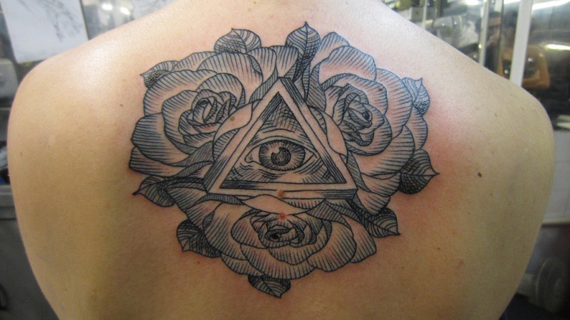 Engraving style colored back tattoo of large roses with mystical symbol