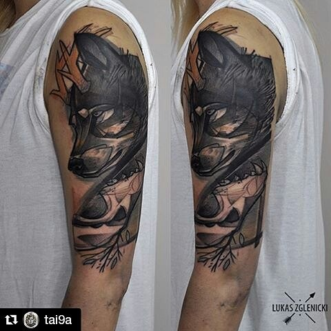 Engraving style colored shoulder tattoo of wolf with skull and horns