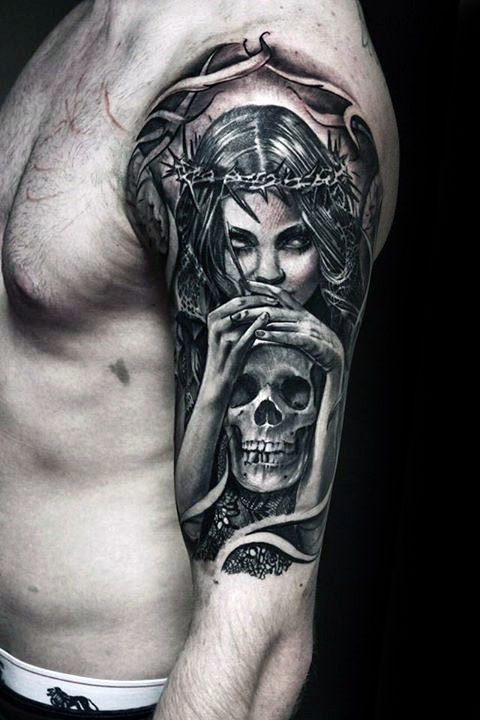 Engraving style colored shoulder tattoo of woman with skull and vine