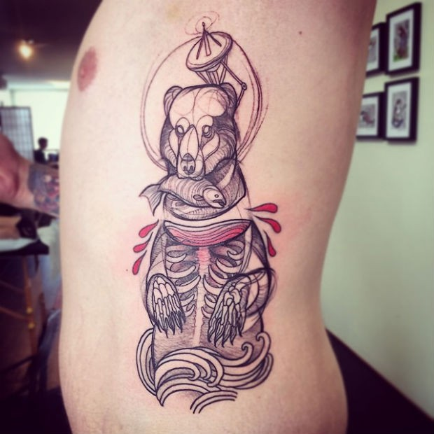 Engraving style colored side tattoo of bear skeleton with fish