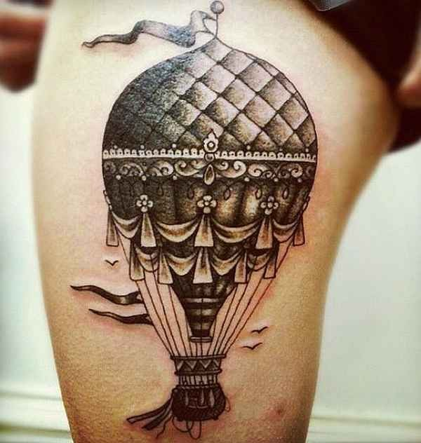 Engraving style colored thigh tattoo fo flying balloon