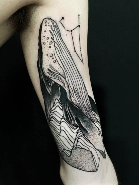 Enormous blackwork style painted by Michele Zingales half sleeve tattoo of whale head