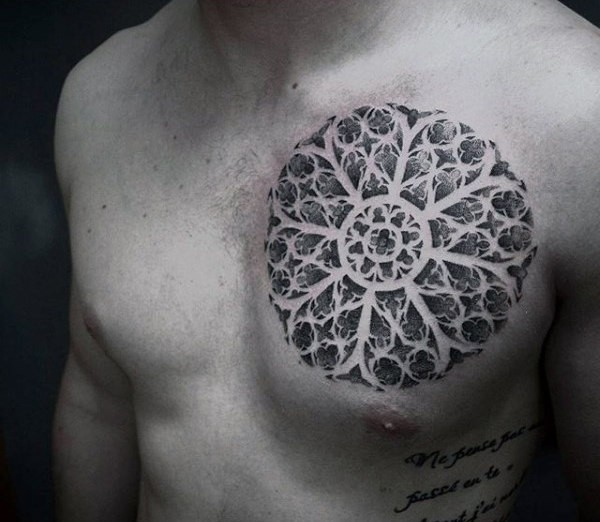 Enormous circle shaped chest tattoo of big floral ornament