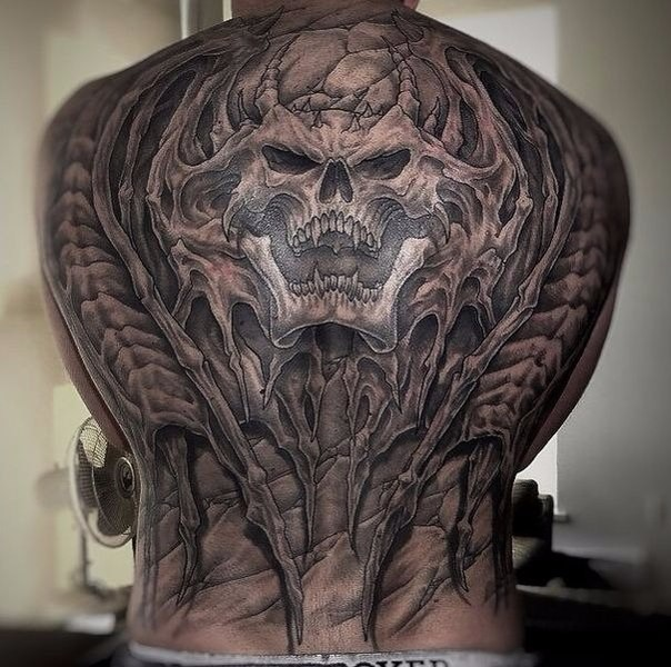 Enormous large very detailed whole back tattoo of alien skeleton